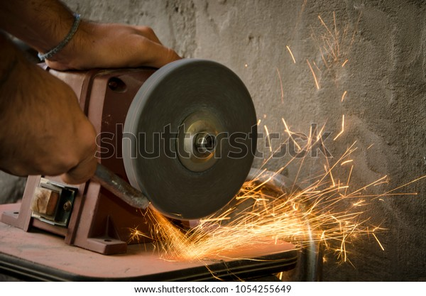 Magnificent Man Use Bench Grinder Sharpening Wick Stock Photo Edit Now Ncnpc Chair Design For Home Ncnpcorg