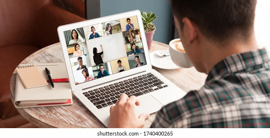 Man use computer laptop with screen of video conference of course online attended by people from many places