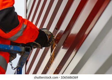 Man use electric Steel cutter and clamp metal and throwing many sharp sparks. industry in construction site concept.