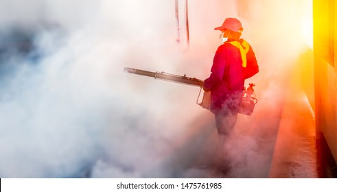 A man use fumigation mosquitoes machine for kill mosquito carrier of Zika virus and dengue fever prevention outbreak in school and homes at the rainy season. Smoke is used to kill mosquitoes.