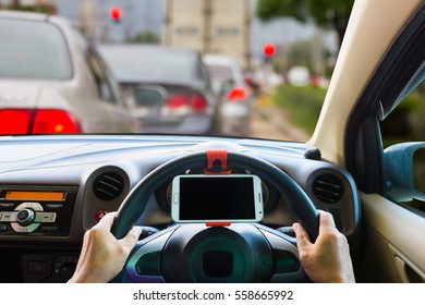 Man  use mobile phone in the car, blur image of traffic jam as background.