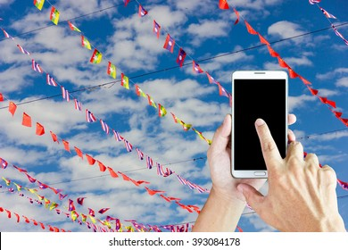 Man use mobile phone, the flag of ASEAN as background.