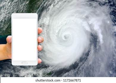 Man use mobile phone, image of a storm as background.(Element of this image furnished by NASA)