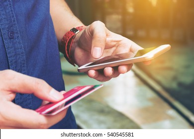Man use smart phone and holding credit card with shopping online. Online payment concept.