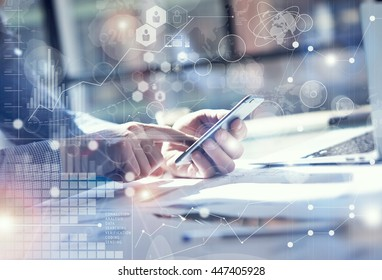 Man Use Smartphone Hand,touch screen.Project Manager Researching Process.Business Team Work Startup modern Office.Global Strategy Virtual Icon.Innovation Graphs Interface.Analyze market stock.Blurred