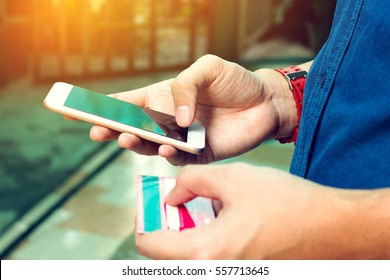 Man use smartphone and holding credit card. Online payment concept.