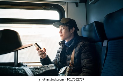 The man use smartphone in train