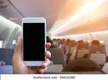 Man use your phone in airplane blurred background - mockup template - sunlight filter effect