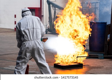 a man used carbon dioxide fire extinguishers  (co2) for Practice a fire drill outdoor
