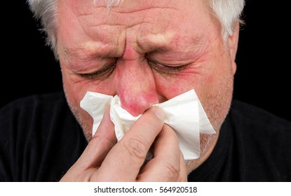 A man uses a handkerchief, he has a strong flu or allergy