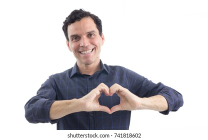 Man uses his hands to form the symbol of a heart. Health. The person is Caucasian and is wearing blue button-down shirt. Isolated. White background.