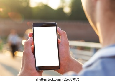 Man uses his Mobile Phone outdoor, close up