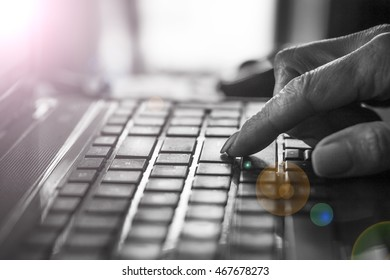 A man uses a laptop. Close-up of hand on the laptop keyboard. Concept: creative, new idea