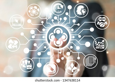 Man uses on a virtual screen of the future and sees the icon: group businessman table round meeting. Conference Partnership Team Work Bisiness concept.