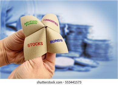 Man uses a paper fortune teller to make multiple decisions for his own portfolio, allocating assets and diversifying in a portfolio to minimize risk for optimal profits. Financial investment concept.