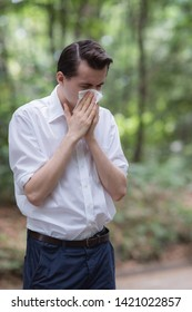 Man uses tissue paper sneezing due to having pollen allergy