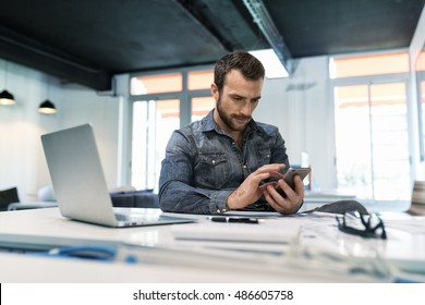 Man using a app mobile phone in modern office start-up. Sms, chat, message
