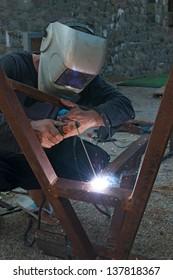 Man using an arc welder