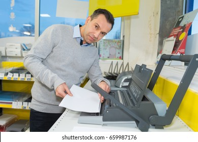 man using a binding machine