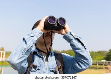 Man using binoculars for birdwatching