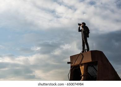man using binoculars,looking concept
