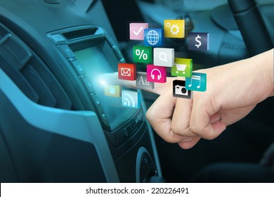 Man using car audio stereo system and pushing on car screen interface, With driver entering cloud of colorful application icon social media networking transportation and vehicle concept idea