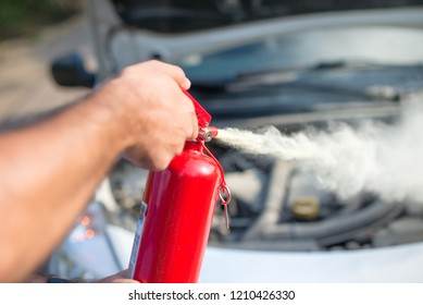 Man using car to extinguish a car fire. Close up shot