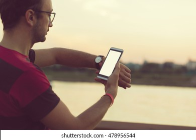Man using cellphone outdoors.