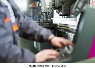 Man using CNC machine