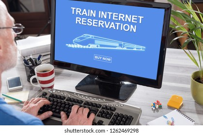 Man using a computer with train internet reservation concept on the screen