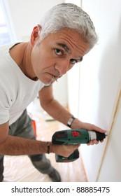 Man using an cordless screwdriver
