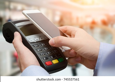 Man using credit card payment machine. Mobile payment with contactless smart phone application