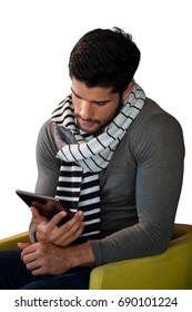 Man using digital tablet against white background