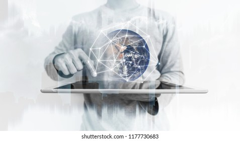 a man using digital tablet with global network connection technology hologram. Element of this image are furnished by NASA