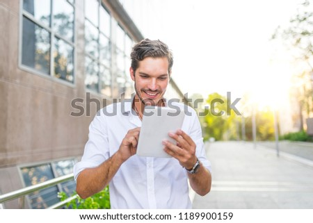 de7b1a0a10 Man Using Digital Tablet Outside Young Stock Photo (Edit Now ...