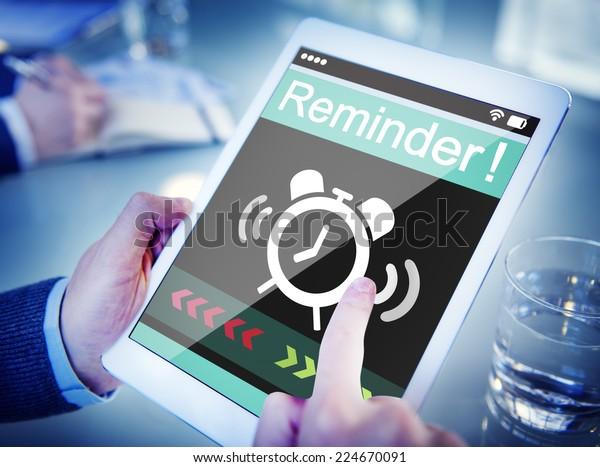 Man Using Digital Tablet with Reminder