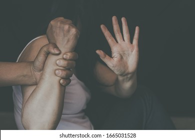 man are using force to coerce women. stop domestic violence against women campaign.