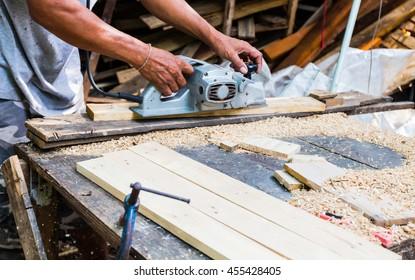 Man using a grinding machine on wood, Wood craft