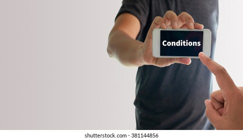 a man using hand holding the smartphone with text conditions on display