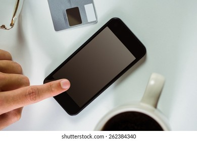 Man using his smart phone in close up