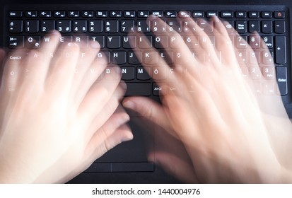 Man is using keyboard quickly for writing on laptop. Top view of caucasian man blurred hand on black computer keyboard.