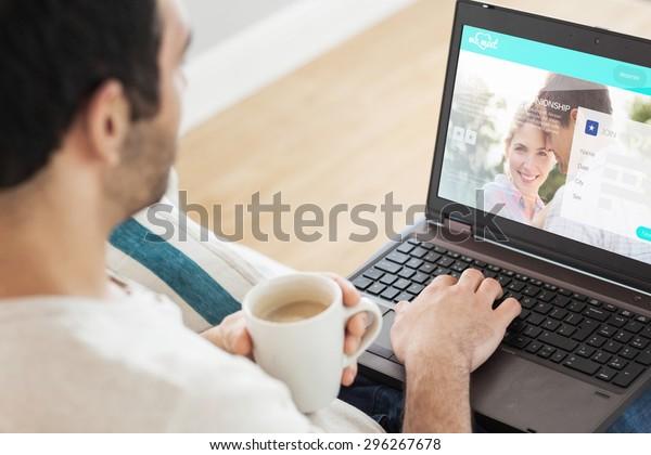 Man using laptop against dating website