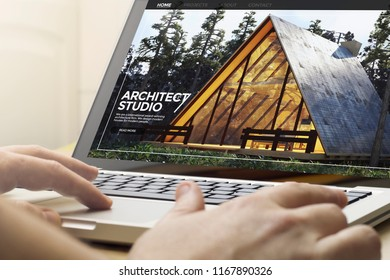man using a laptop with architect studio website on the screen. Screen graphics are made up.