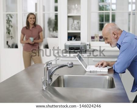Man using laptop by