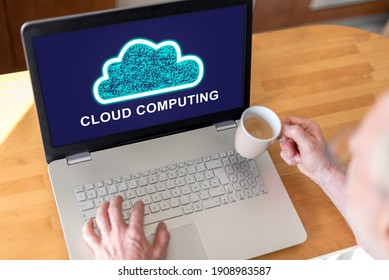 Man using a laptop with cloud computing concept on the screen