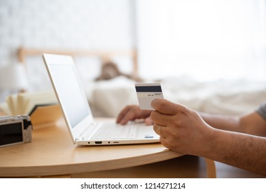 Man using laptop and credit card to shopping online