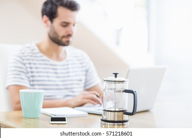 A Man is using a laptop at home