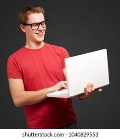 Man using laptop isolated on black background