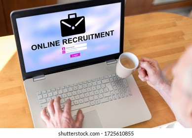 Man using a laptop with online recruitment concept on the screen