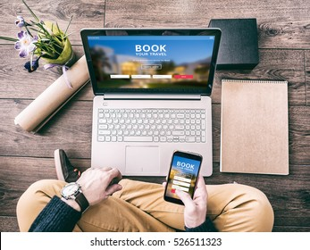 Man using a laptop and smartphone for booking hotel online. Tour reservation, Screen graphics are made up.